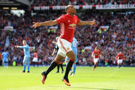 Anthony Martial of Man Utd celebrates after scoring their 1st goal against Stoke in the Premier League
