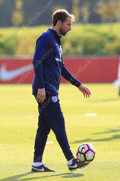 England interim manager Gareth Southgate gets involved with an open training session at St. George's Park