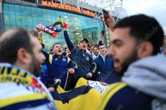 Fenerbahce fans wave scarves outside Old Trafford ahead of their side's match against Manchester United in the UEFA Europa League