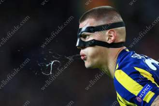 Wearing a protective face mask, Martin Skrtel of Fenerbahce spits