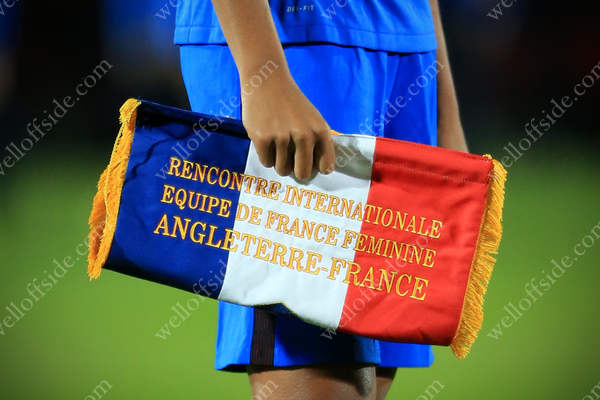 Wendie Renard of France holds the commemorative match pennant before her side take on England in a Women's international friendly in Doncaster