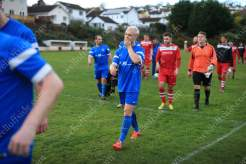 Dejection for a Brixham player following his side's 3-0 defeat