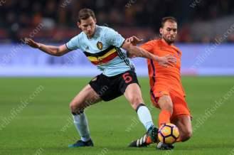 Jan Vertonghen of Belgium battles with Bas Dost of Netherlands