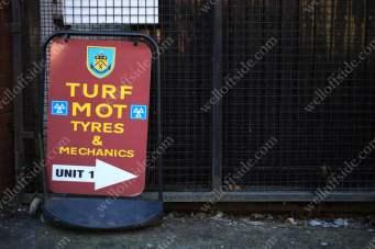 A sign for Turf MOT Tyres & Mechanics