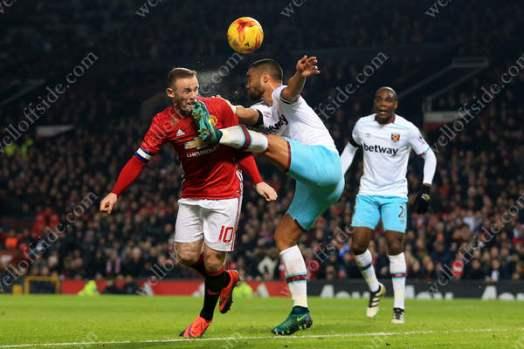 Winston Reid of West Ham kicks Wayne Rooney of Man Utd in the face