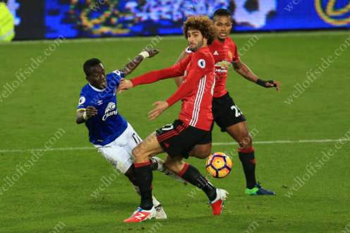 Moments after coming on, Marouane Fellaini of Man Utd fouls Idrissa Gueye of Everton to concede a penalty