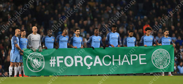 Man City players hold a banner before their UEFA Champions League clash with Celtic reading #ForcaChape as they observe a minute's silence in memory of the victims of the plane crash in South America which killed many players from Brazilian club Chapecoense