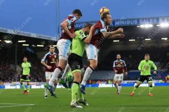 Michael Keane of Burnley (L) and Scott Arfield of Burnley combine to shut out Simon Francis of Bournemouth