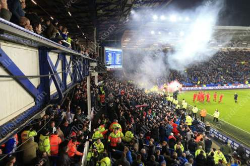 Smoke fills the air as Liverpool fans celebrate their late winner