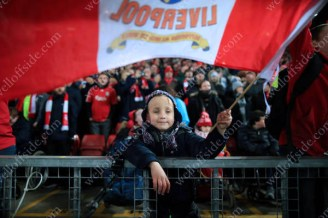 A young Liverpool fan waves his flag before the League Cup Semi-Final (2nd Leg) match against Southampton