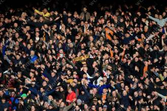 Wolves fans celebrate their side's victory over Liverpool