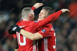 Bastian Schweinsteiger of Man Utd celebrates with teammate Wayne Rooney after scoring their 4th goal against Wigan Athletic in the FA Cup 4th Round