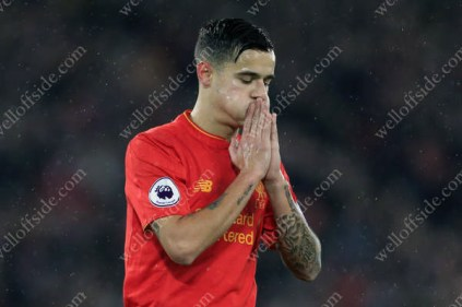 Philippe Coutinho of Liverpool looks dejected