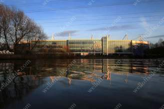 Leicester City's King Power Stadium reflected in the water of the nearby River Soar