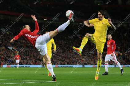 Zlatan Ibrahimovic of Man Utd battles with Cesar Navas of Rostov during their UEFA Europa League Last 16 (2nd Leg) tie