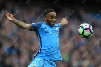 Raheem Sterling of Man City controls the bouncing ball