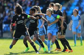 Steph Houghton of Man City is held back by a host of Lyon players during their UEFA Women's Champions League Semi-Final (1st Leg) match