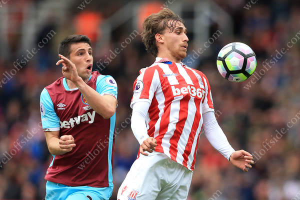 Jonathan Calleri of West Ham battles with Marc Muniesa of Stoke