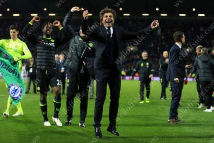 Chelsea manager Antonio Conte celebrates winning the title