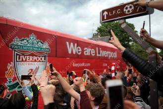 Liverpool fans watch as the team bus approaches the stadium