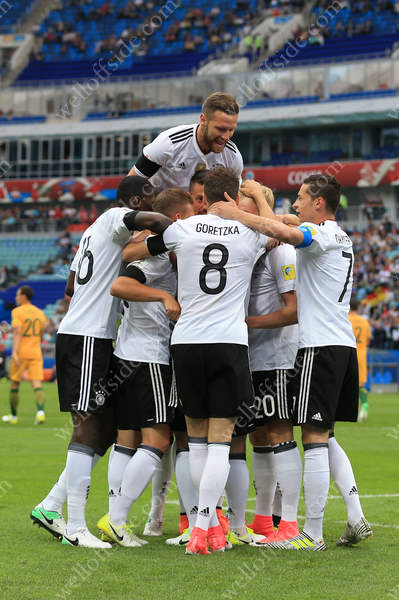 Shkodran Mustafi of Germany jumps on top of his teammates as they celebrate their 1st goal