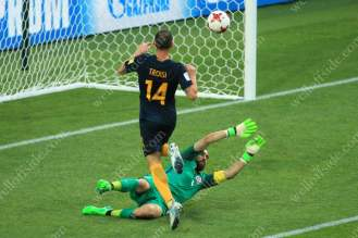 James Troisi of Australia chips the ball over Chile goalkeeper Claudio Bravo and scores their 1st goal