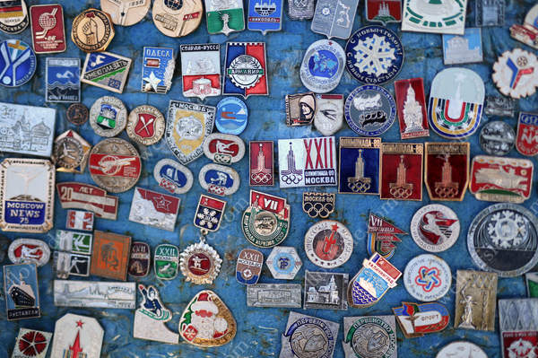 Souvenir pins and badges for sale on a stall by Red Square