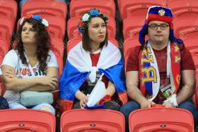 Russian fans look dejected as their team are eliminated