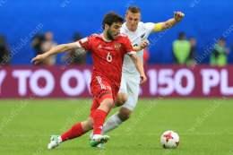 Georgi Dzhikiya of Russia battles with Chris Wood of New Zealand