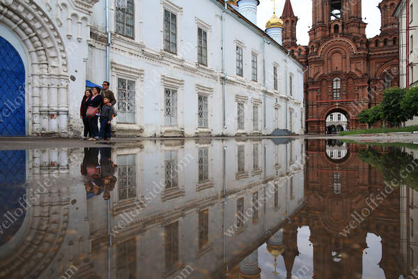 A reflection in the water outside the bell tower of the Cathedral of the Epiphany