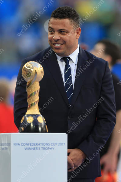 Brazilian legend Ronaldo poses with the trophy during the closing ceremony