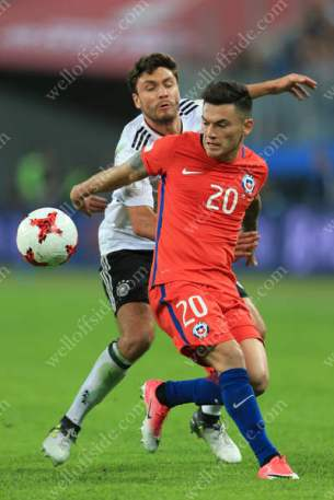 Charles Aranguiz of Chile battles with Jonas Hector of Germany