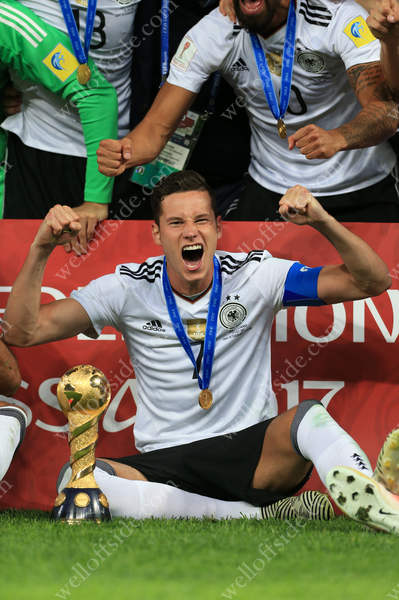 Player of the Tournament, Germany's Julian Draxler, celebrates with the trophy