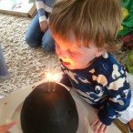The birthday boy gets to blow out the candles