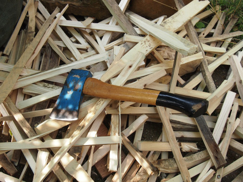 an axe, some wooden tongs to hold the piece upright, and some iced coffee