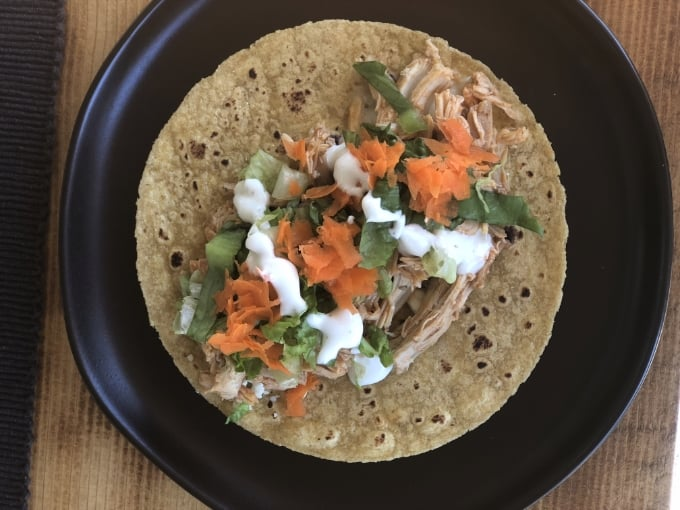 Shredded chicken, lettuce, carrots, green onion and ranch dressing on tortilla
