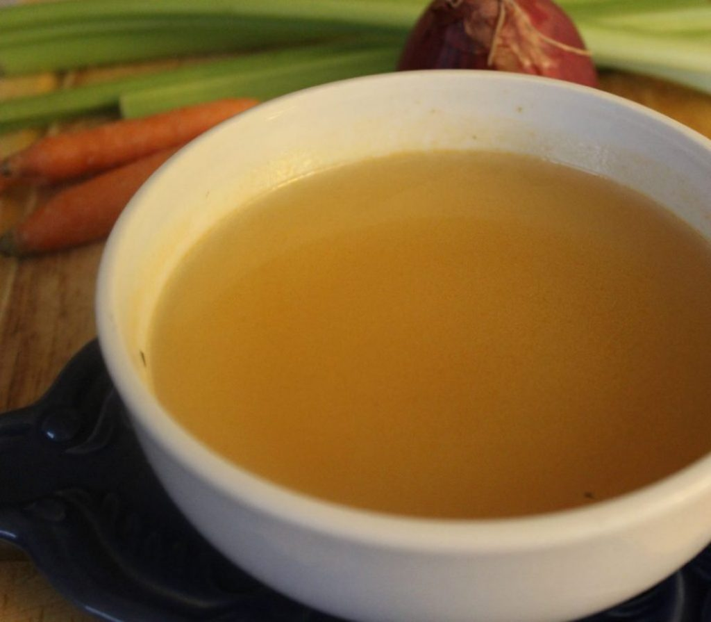 Homemade vegetable broth from vegetable scraps