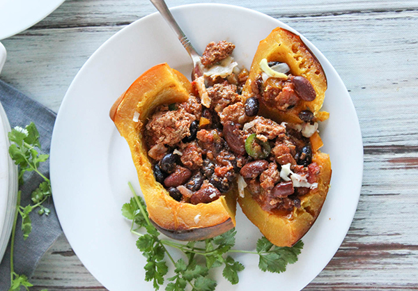 an overhead shot of stuffed squash on a plate with a fork