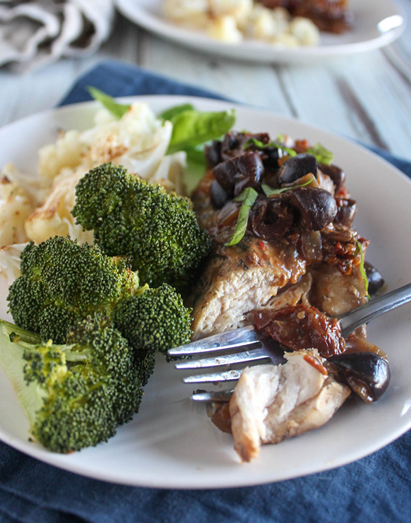 Slow cooker Mediterranean on a plate with broccoli and a fork
