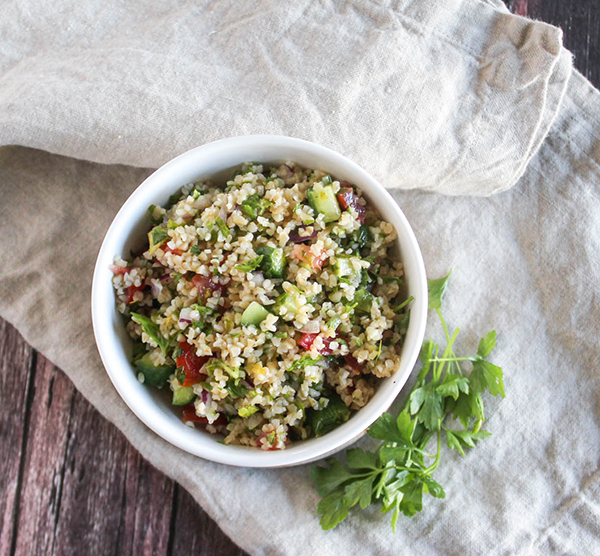 an overhead view of tabbouleh salad in a bowl