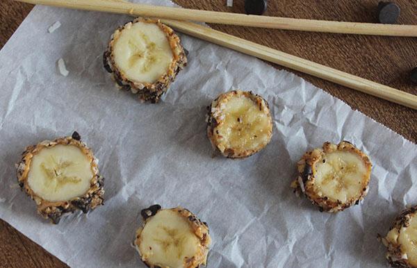Banana sushi on a tray with chop sticks