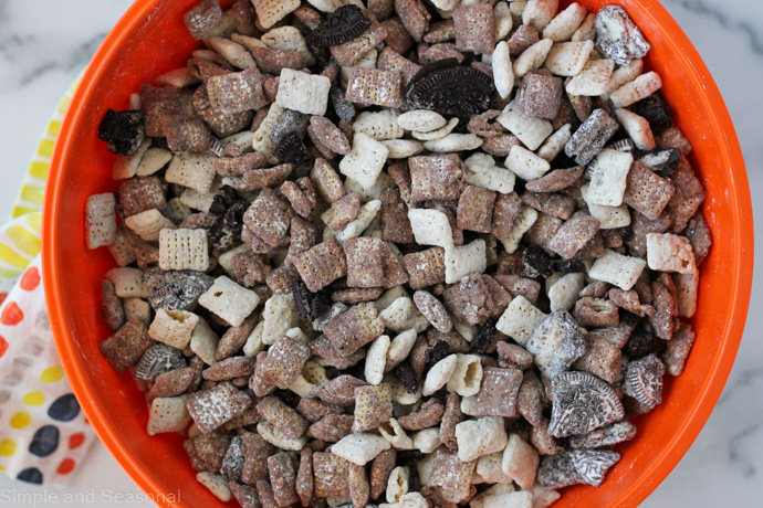 top down view of a bowl of cookies and cream chex mix