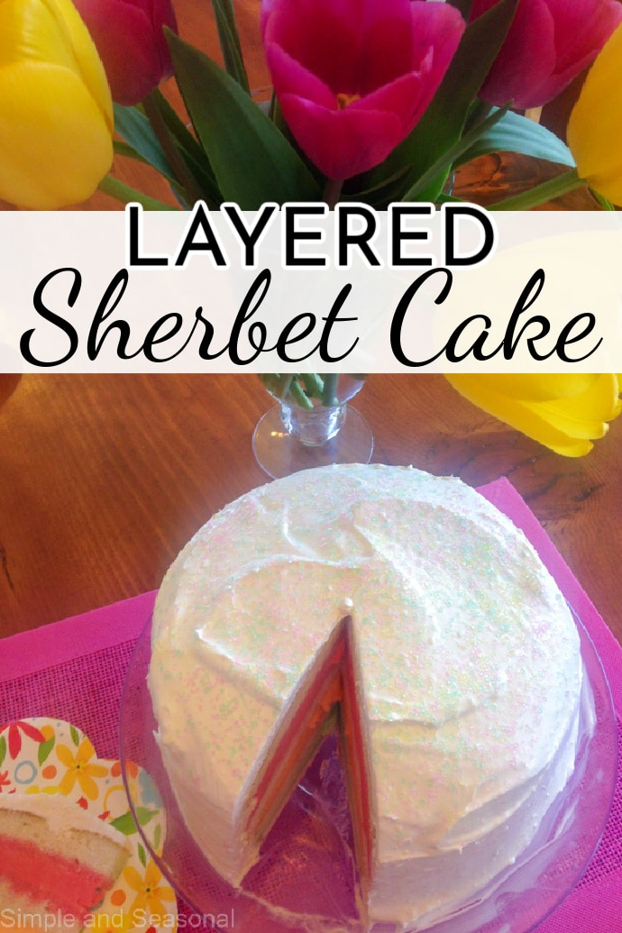 whole cake with slice removed showing colored layers