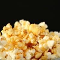 closeup of marshmallow caramel sauce poured over popcorn