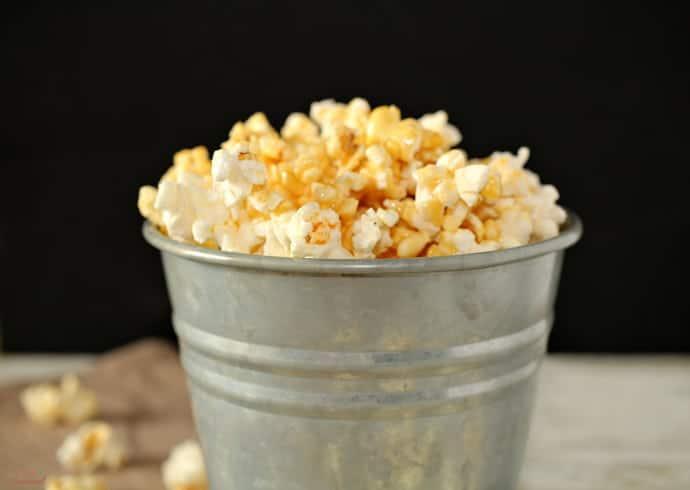 marshmallow caramel popcorn in a silver bucket