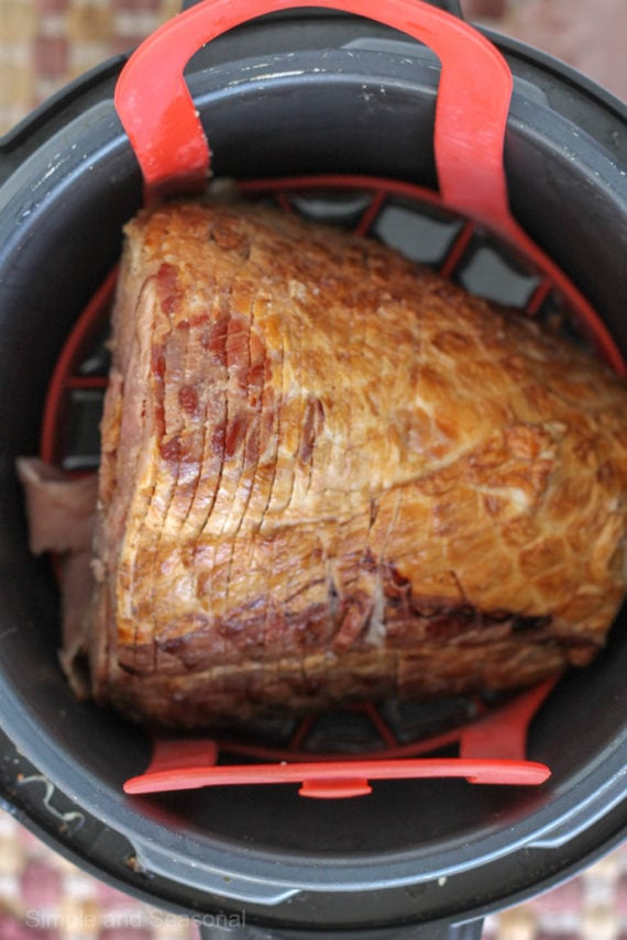 Save space in the oven by making Crockpot Express Ham. Add a delicious copycat HoneyBaked ham glaze for the perfect holiday dinner.