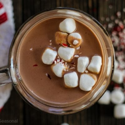top down view of crockpot express hot chocolate in a mug with marshmallows and crushed peppermint