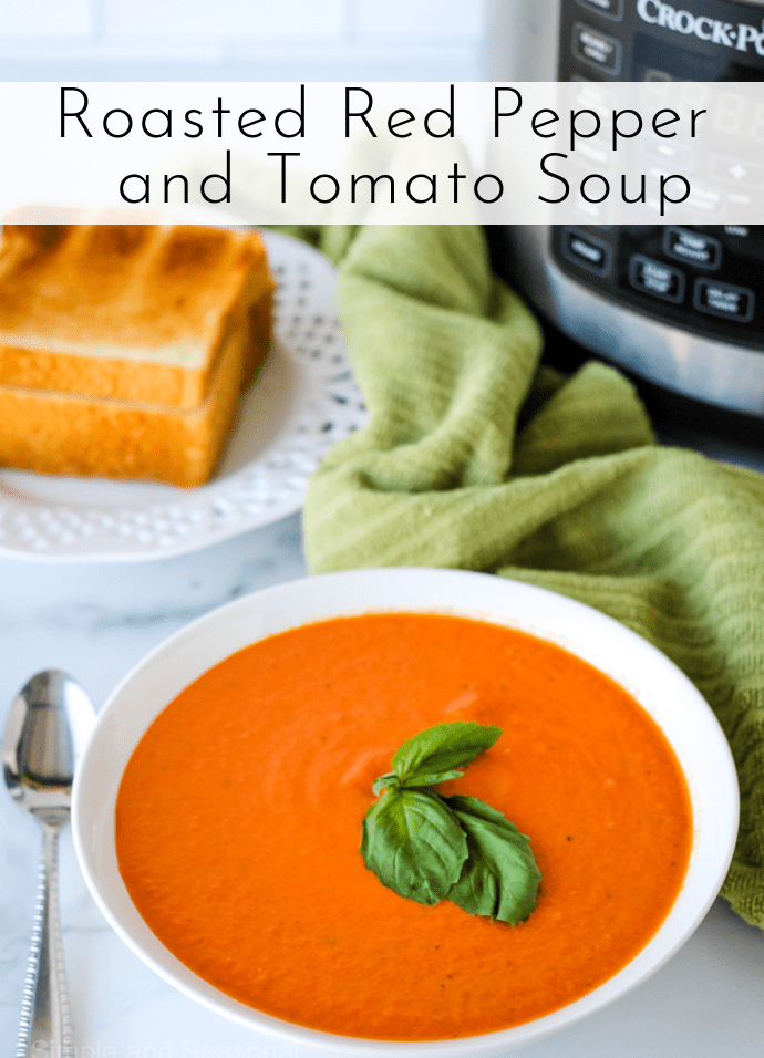 red soup in a white bowl with a green basil leaf on top: text label reads Roasted Red Pepper and Tomato Soup