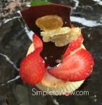 mini cheese cake with strawberry and chocolate garnish