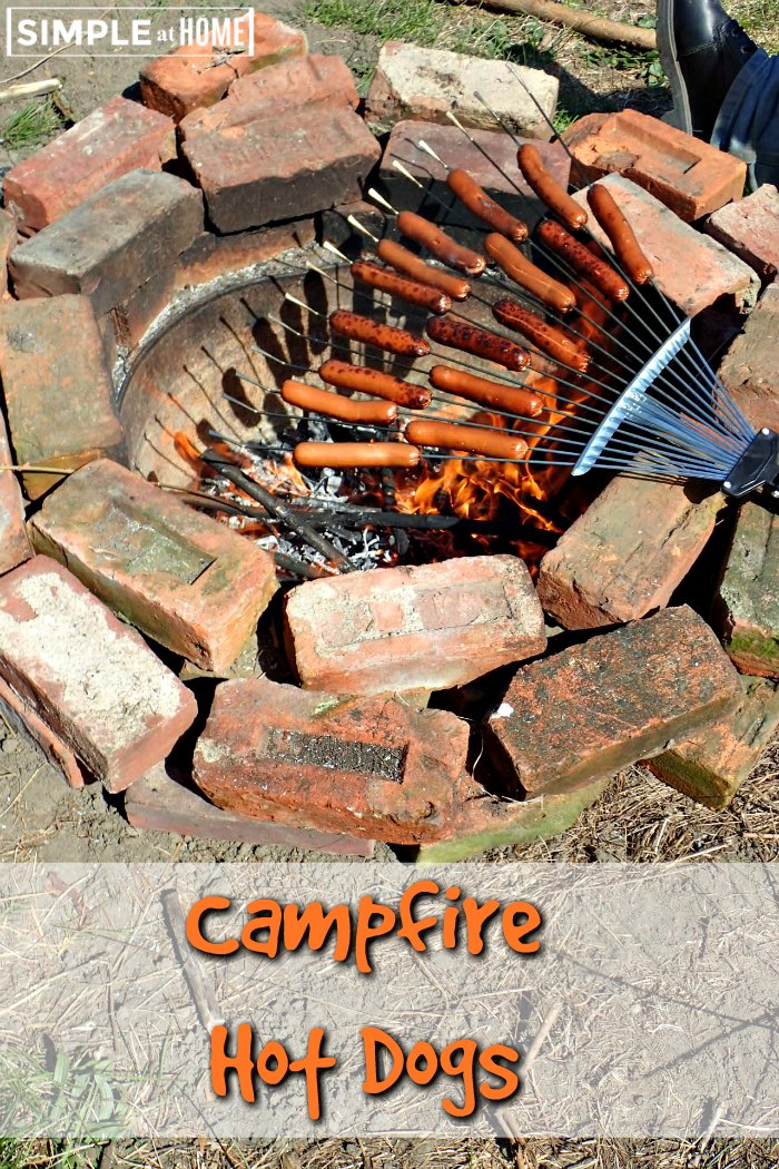 How to cook hot dogs over a campfire... with a rake?